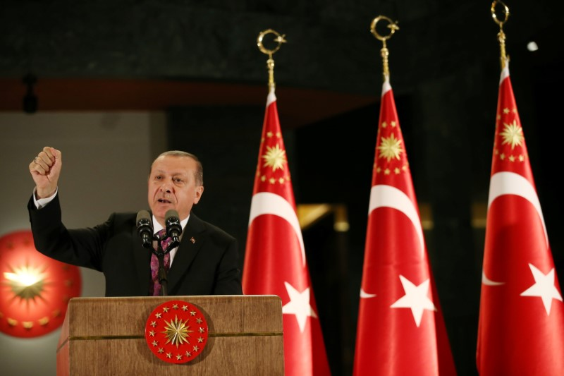 Turkish President Tayyip Erdogan makes a speech during a fast-breaking iftar dinner at the Presidential Palace in Ankara, Turkey, June 20, 2017. Yasin Bulbul/Presidential Palace/Handout via REUTERS