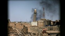 Al-Hadba minaret at the Grand Mosque is seen through a building window in the old city of Mosul, Iraq June 1, 2017. REUTERS/Alaa Al-Marjani