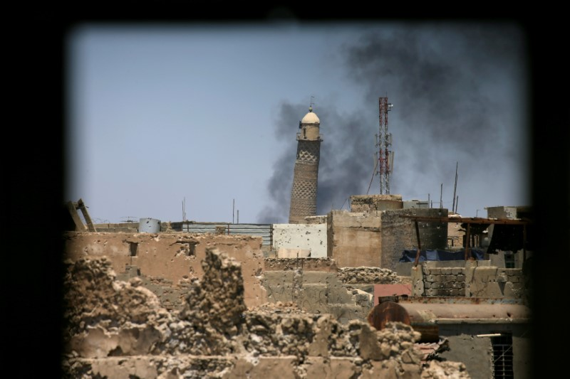 Al-Hadba minaret at the Grand Mosque is seen through a building window in the old city of Mosul, Iraq June 1, 2017. REUTERS/Alaa Al-Marjani