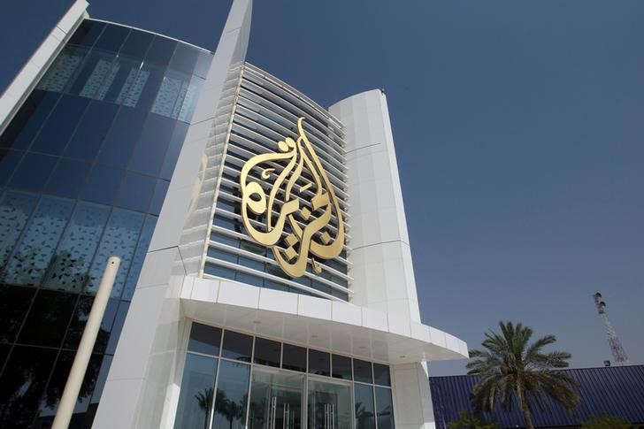 The Al Jazeera Media Network logo is seen on its headquarters building in Doha, Qatar June 8, 2017. REUTERS/Naseem Zeitoon - RTX39N4R