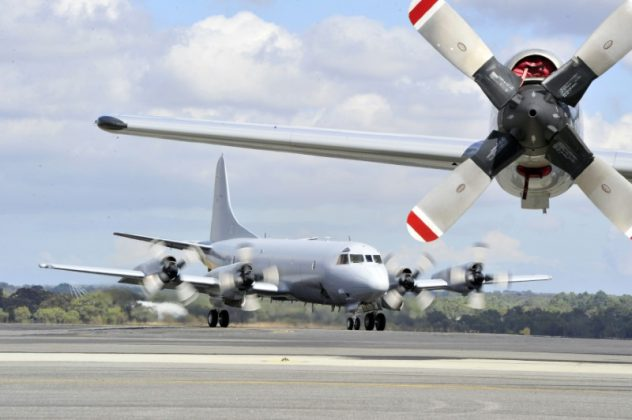 FILE PHOTO - A Royal Australian Air Force (RAAF) Orion aircraft (back) prepares to take off from RAAF Base Pearce near Perth April 6, 2014. REUTERS/Richard Polden