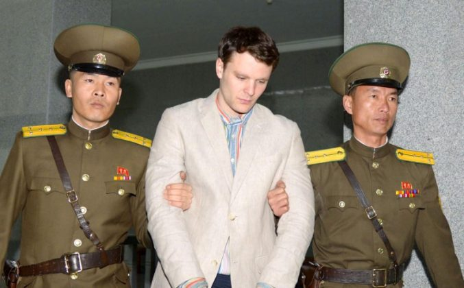 FILE PHOTO - Otto Frederick Warmbier (C), a University of Virginia student who was detained in North Korea since early January, is taken to North Korea's top court in Pyongyang, North Korea, in this photo released by Kyodo March 16, 2016. Mandatory credit REUTERS/Kyodo
