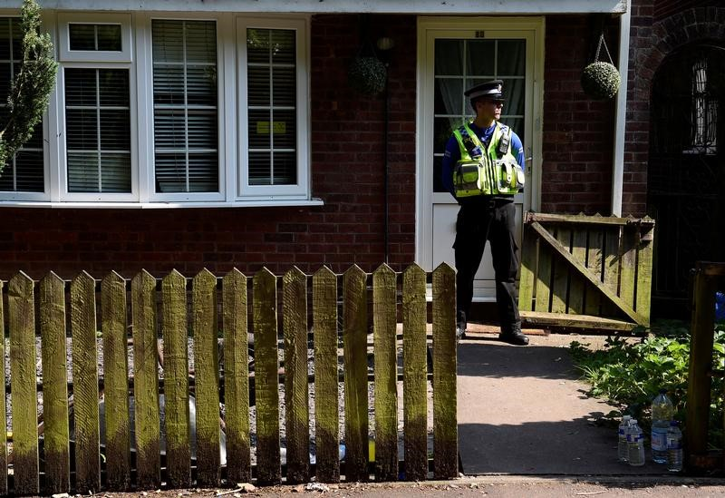 A police officer stands outside the home of Darren Osborne, in Cardiff, Wales June 20, 2017. REUTERS/Rebecca Naden