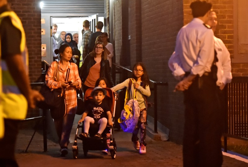Residents are evacuated from the Taplow Tower residential block as a precautionary measure following concerns over the type of cladding used on the outside of the building on the Chalcots Estate in north London, Britain, June 23, 2017. REUTERS/Hannah McKay
