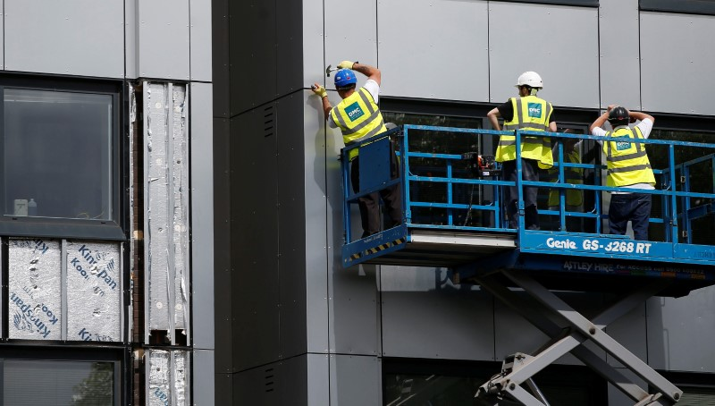 Cladding is removed from the side of Whitebean Court in Salford, Manchester,