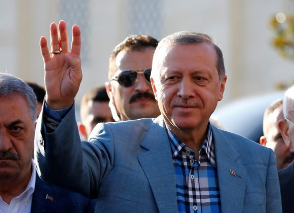 Turkey's President Tayyip Erdogan greets his supporters as he leaves a mosque after the Eid al-Fitr prayers in Istanbul, Turkey, June 25, 2017. REUTERS/Murad Sezer