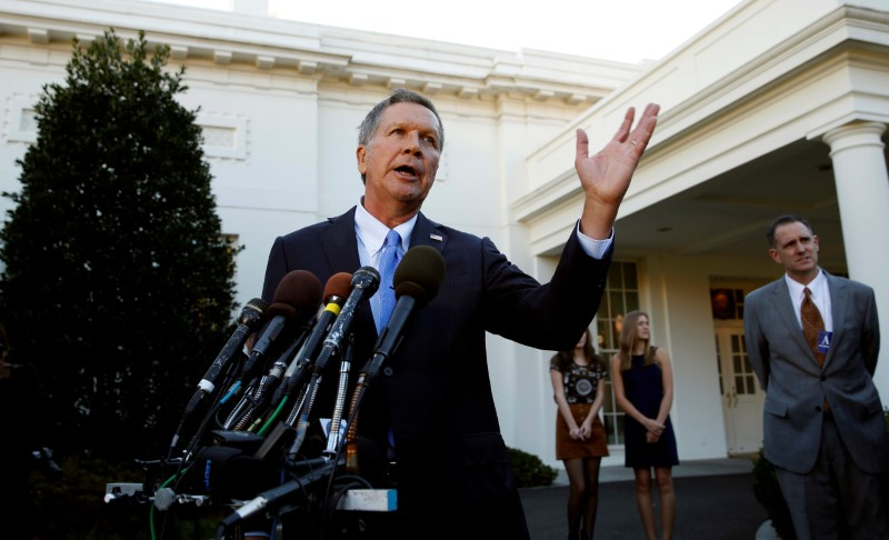 FILE PHOTO: Ohio Governor John Kasich speaks to reporters after an event at the White House in Washington, U.S., on November 10, 2016. REUTERS/Kevin Lamarque/File Photo