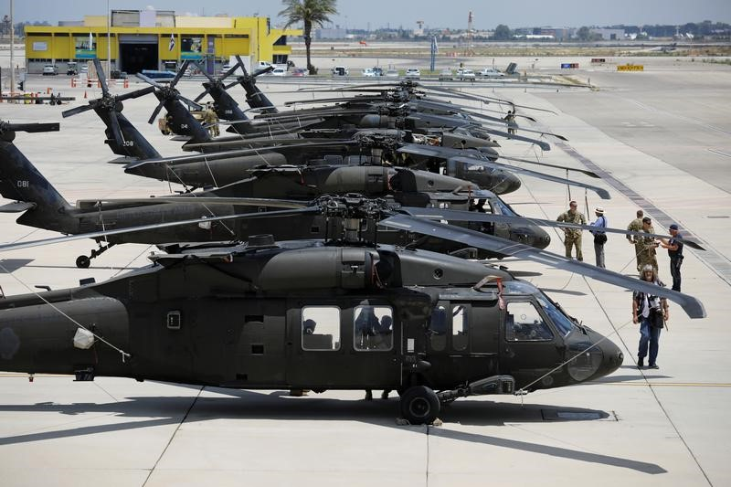 American Black Hawk helicopters are parked in a row during a dress rehearsal of the arrival ceremony which will be held to welcome U.S. President Donald Trump upon his arrival, at Ben Gurion International Airport in Lod, Israel May 21, 2017. REUTERS/Amir Cohen