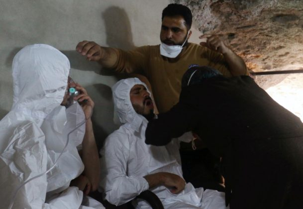 FILE PHOTO: A man breathes through an oxygen mask as another one receives treatments, after what rescue workers described as a suspected gas attack in the town of Khan Sheikhoun in rebel-held Idlib, Syria April 4, 2017. REUTERS/Ammar Abdullah
