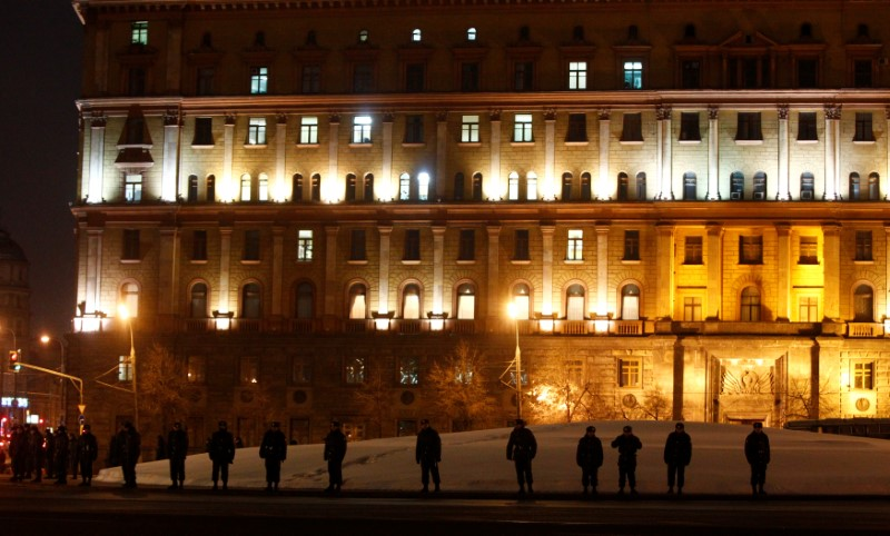 FILE PHOTO: Police guard the FSB headquarters during an opposition protest in Moscow, Russia, on March 5, 2012. REUTERS/Mikhail Voskresensky/File Photo