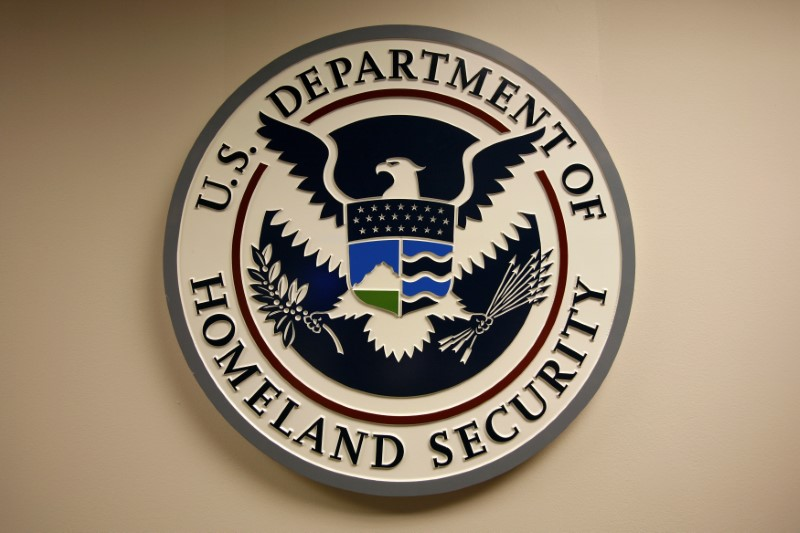 Department of Homeland Security emblem is pictured at the National Cybersecurity & Communications Integration Center (NCCIC) located just outside Washington in Arlington, Virginia September 24, 2010. REUTERS/Hyungwon Kang/File Photo