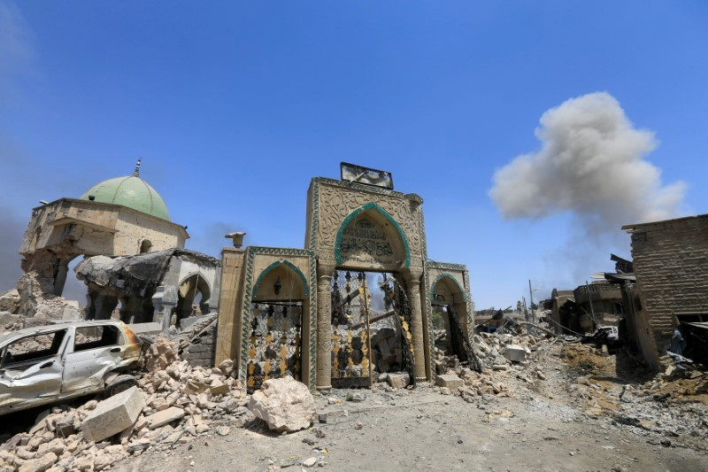 The ruined Grand al-Nuri Mosque is seen after it was retaken by the Iraqi forces from the Islamic State militants at the Old City in Mosul, Iraq, June 30, 2017. REUTERS/Alaa Al-Marjani