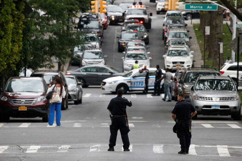 NYPD officers work outside Bronx-Lebanon Hospital, after an incident in which a gunman fired shots inside the hospital in New York City, U.S. June 30, 2017. REUTERS/Brendan McDermid