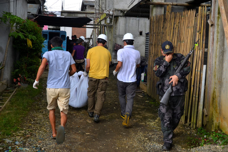 A group of rescue volunteers carry a body they found at the beginning of the fight between government troops and Maute group militants in Marawi, Philippines May 28, 2017. Picture taken May 28, 2017. Lanao del Sur Provincial Disaster Risk Reduction and Management