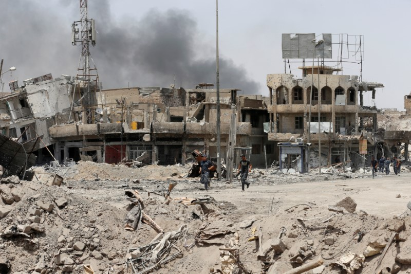Destroyed buildings from clashes are seen during the fight with the Islamic States militants in the Old City of Mosul, Iraq July 3,