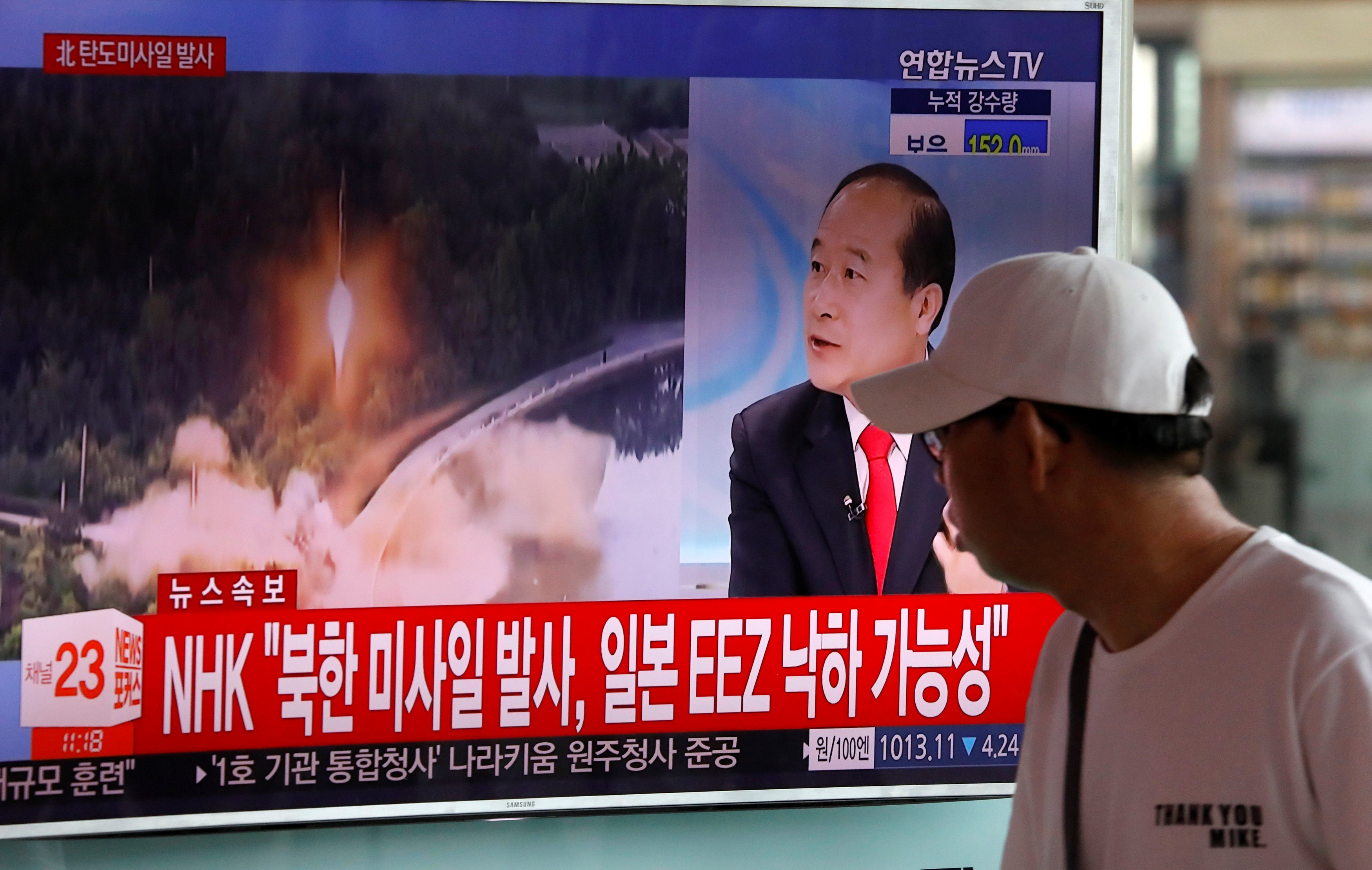 A man watches a TV broadcast of a news report on North Korea's ballistic missile test, at a railway station in Seoul, South Korea, July 4, 2017. REUTERS/Kim Hong-Ji