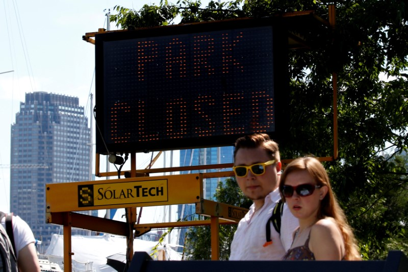 "A ""Park Closed"" sign is seen at an entrance to Liberty State Park during a partial state government shutdown in Jersey City, New Jersey U.S., July 3, 2017. REUTERS/Brendan McDermid"