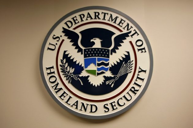 FILE PHOTO: U.S. Department of Homeland Security emblem is pictured at the National Cybersecurity & Communications Integration Center (NCCIC) located just outside Washington in Arlington, Virginia September 24, 2010. REUTERS/Hyungwon Kang/File Photo -