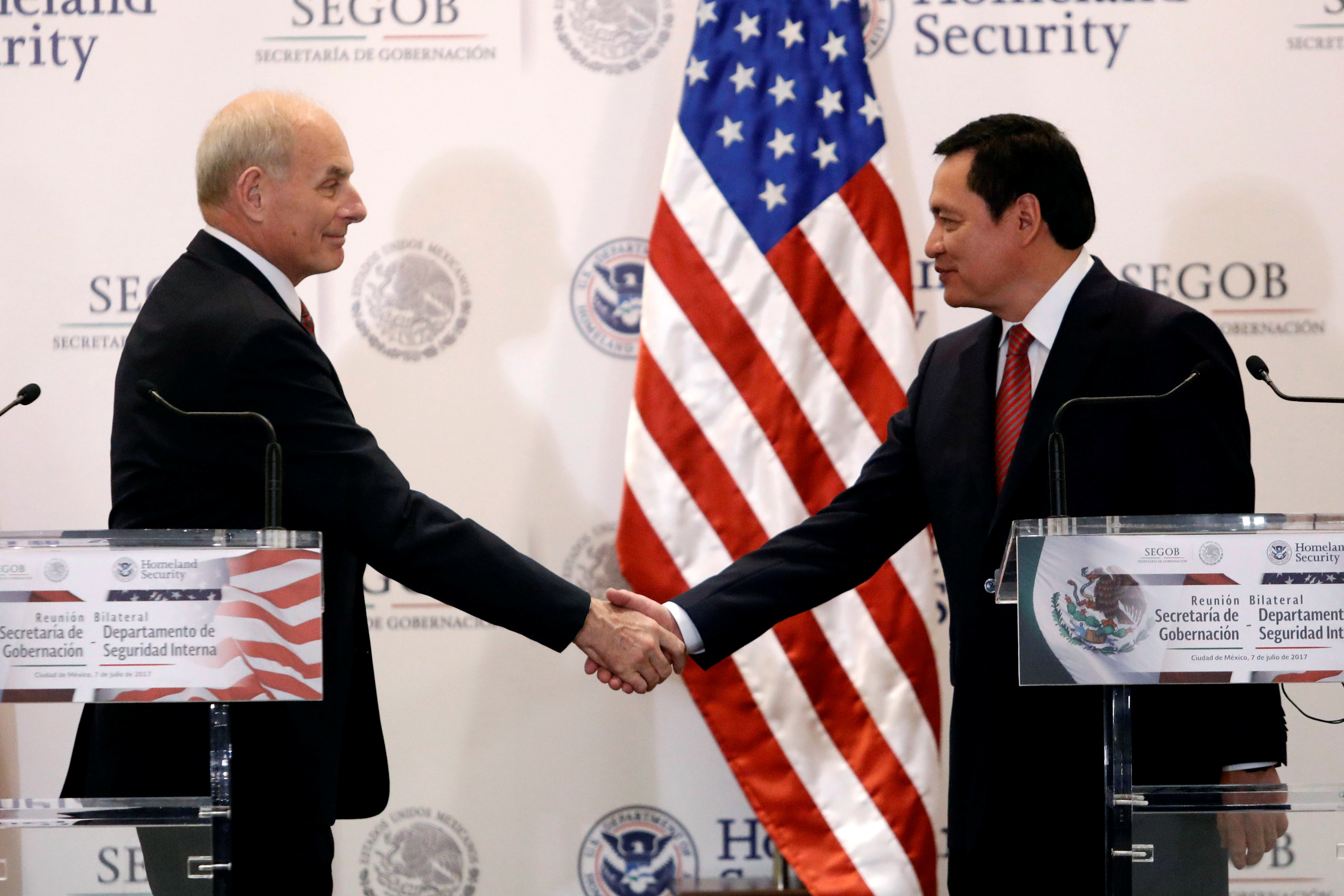 U.S. Secretary of Homeland Security John Kelly shake hands with Mexico's Interior Minister Miguel Angel Osorio Chong after deliver a joint message at the Secretary of Interior Building in Mexico City, Mexico, July 7, 2017. REUTERS/Edgard Garrido