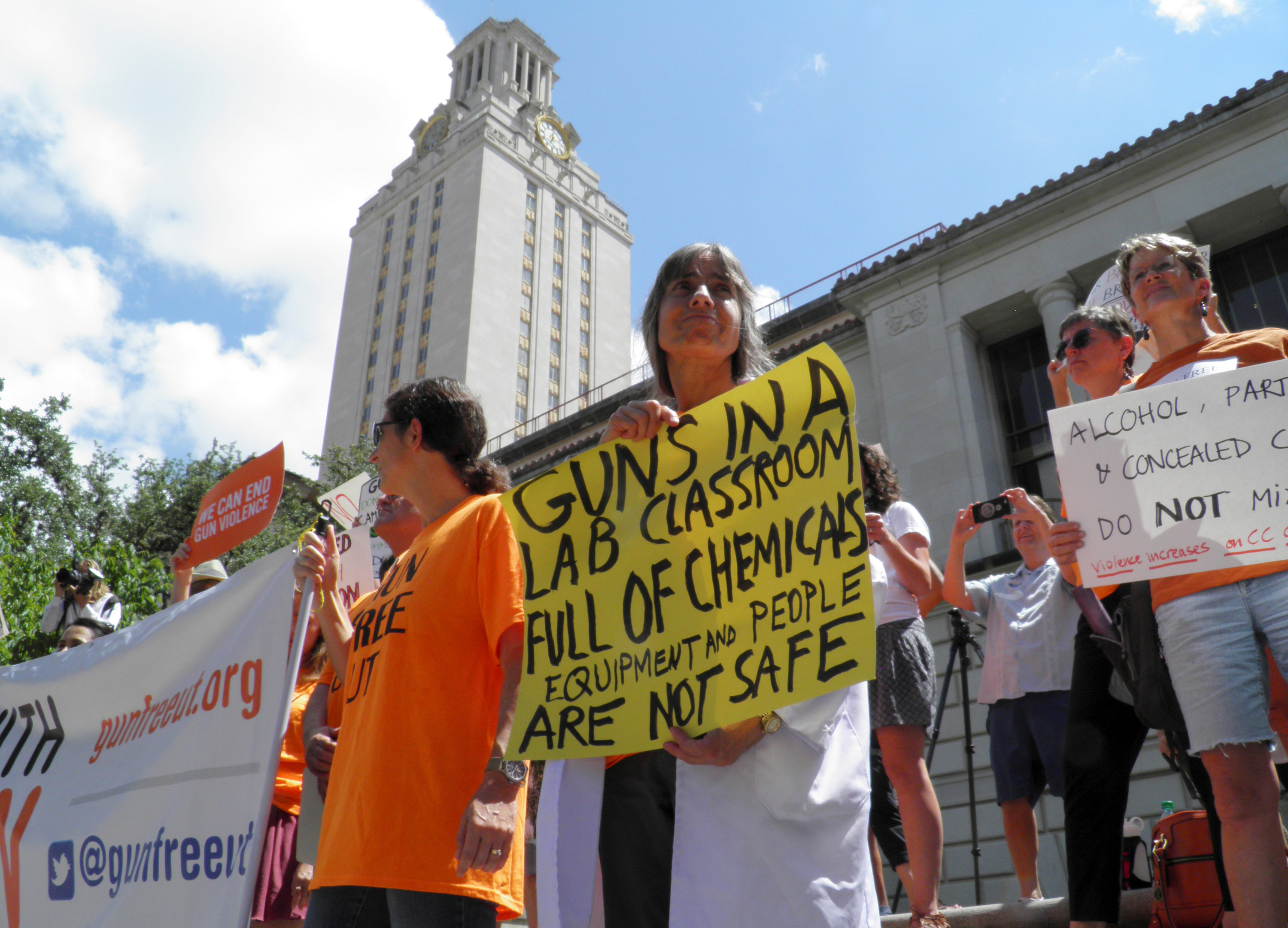 FILE PHOTO: Members of the University of Texas of the Guns Free UT group that includes faculty and staff protest against a state law that allows for guns in classrooms at college campuses, in Austin, Texas, U.S. August 24, 2016. REUTERS/Jon Herskovitz/File Photo
