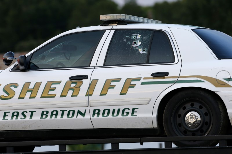 An East Baton Rouge Sheriff vehicle is seen with bullet holes in its windows near the scene where police officers were shot, in Baton Rouge, Louisiana, U.S. July 17, 2016. REUTERS/Jonathan Bachman