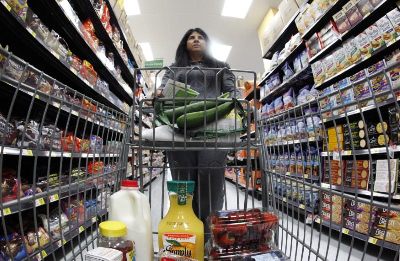 - A shopper walks down an aisle in a Walmart Neighborhood Market in Chicago
