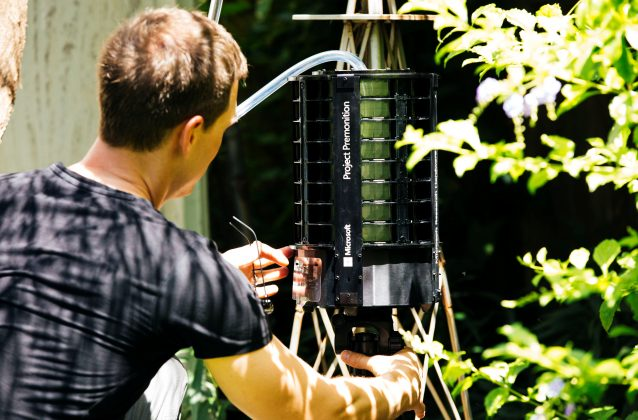 Researcher Ethan Jackson places the Project Premonition mosquito trap in the wild in this handout photo obtained by Reuters June 30, 2017. Microsoft/Handout via REUTERS