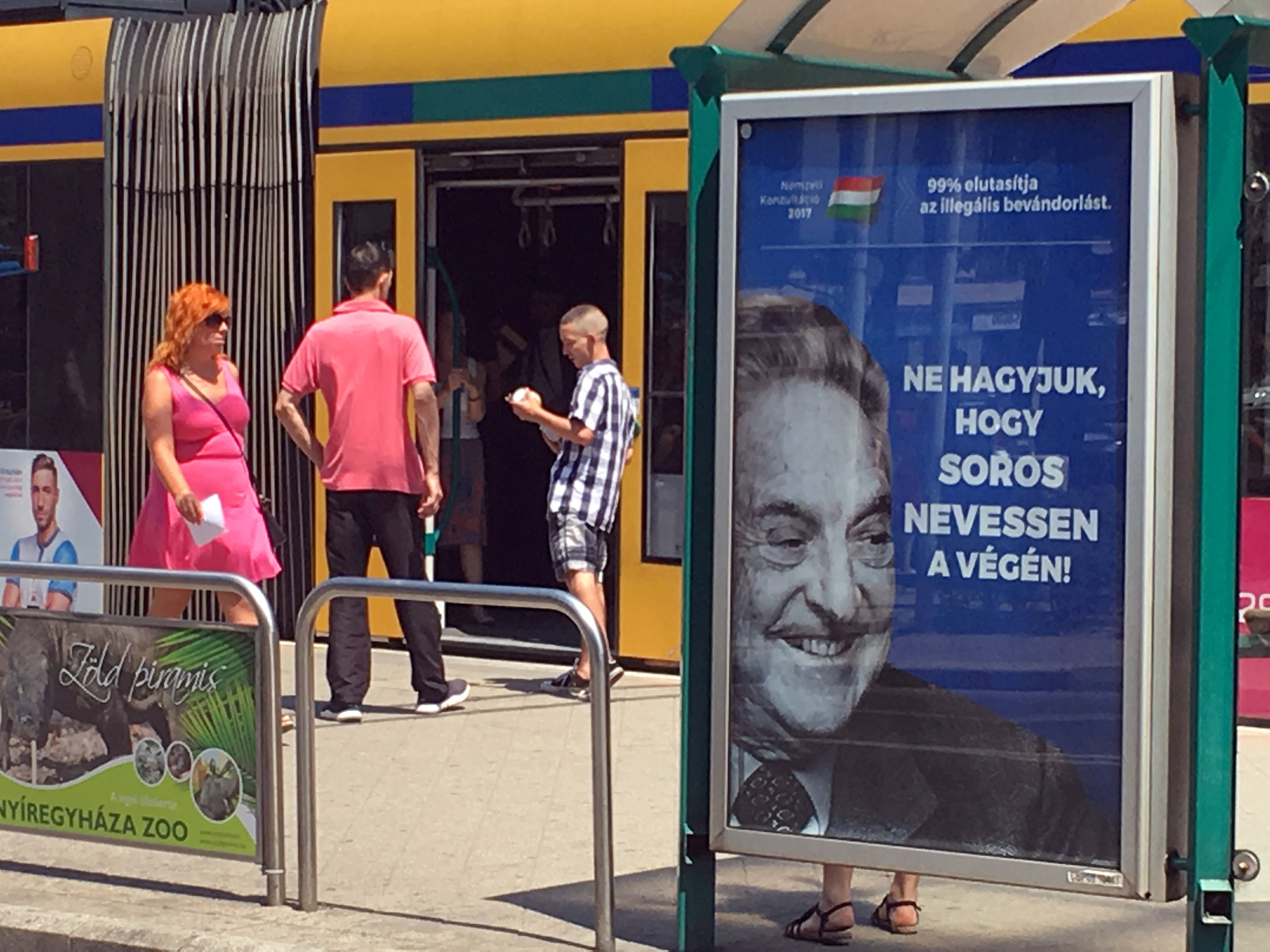 "FILE PHOTO: Hungarian government poster portraying financier George Soros and saying ""Don't let George Soros have the last laugh"" is seen at a tram stop in Budapest, Hungary July 6, 2017. REUTERS/Krisztina Than/File Photo"