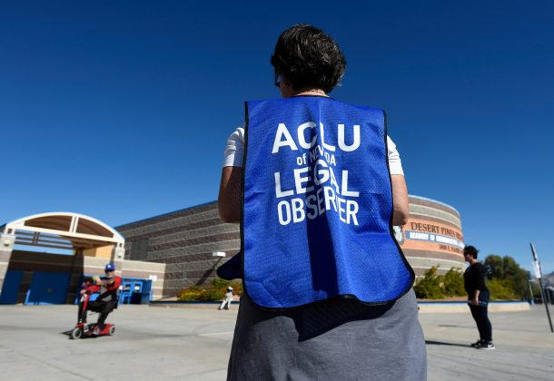 FILE PHOTO - A member of the ACLU observes a polling station during voting in the 2016 presidential election at Desert Pines High School in Las Vegas, Nevada, U.S. on November 8, 2016. REUTERS/David Becker/File Photo