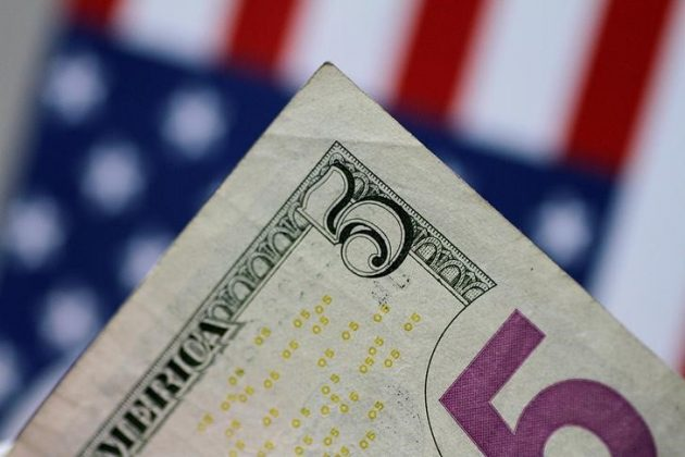 A U.S. five dollar note is seen in this picture illustration June 2, 2017. REUTERS/Thomas White/Illustration