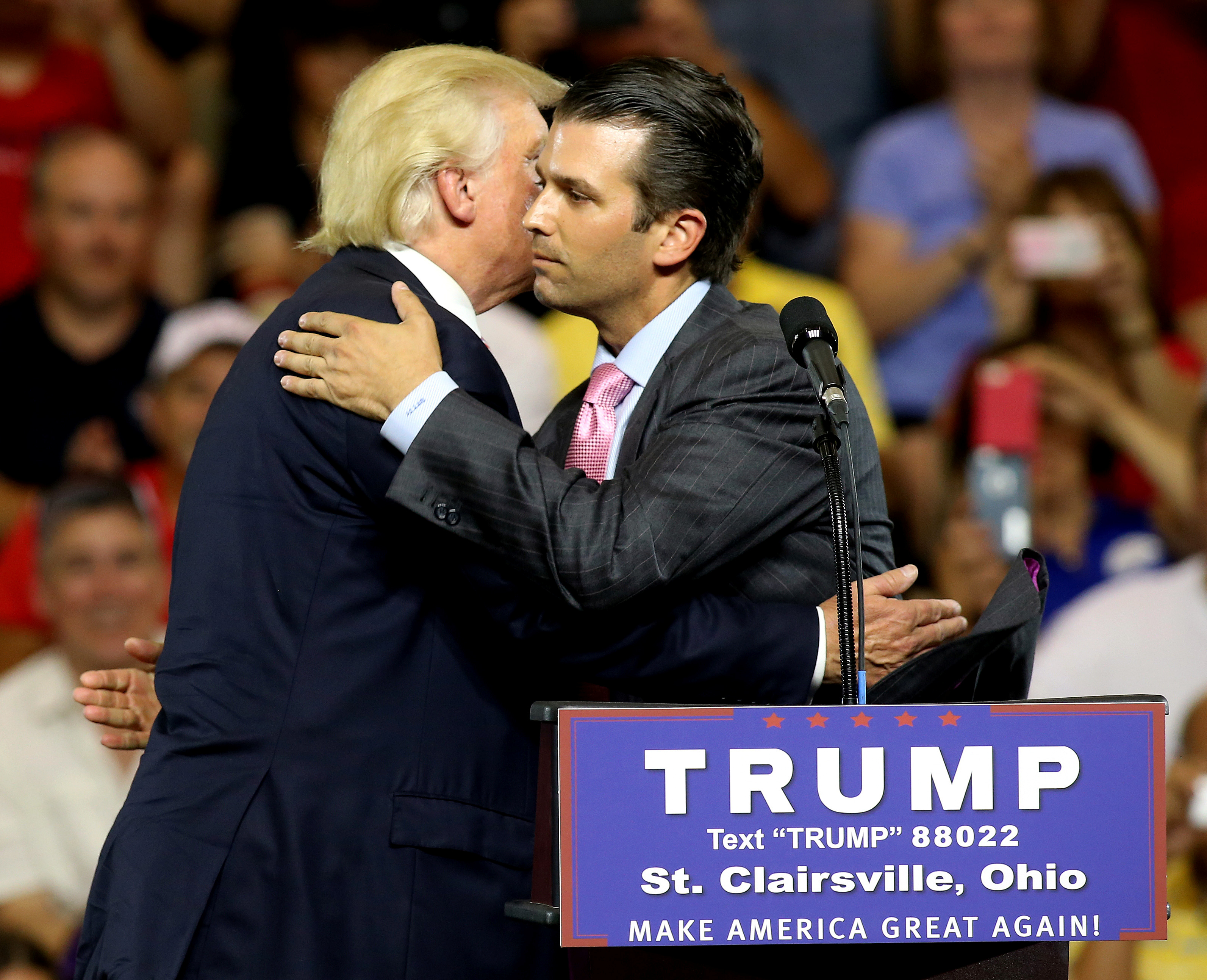 Donald Trump hugs his son Donald Trump Jr. at a campaign rally in St. Clairsville, Ohio June 28, 2016. REUTERS/Aaron Josefczyk