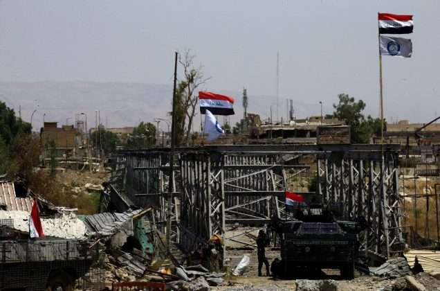 A military vehicle of Iraqi security forces is seen next to an old bridge destroyed by clashes in the Old City of Mosul, Iraq July 10, 2017. REUTERS/Thaier Al-Sudani