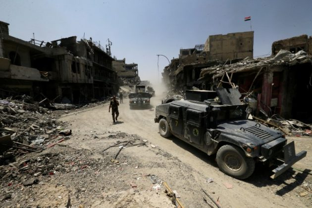 FILE PHOTO: Military vehicles of Iraqi Counter Terrorism Service (CTS) personnel are pictured in the Old City of Mosul, Iraq July 10, 2017. REUTERS/Thaier Al-Sudani