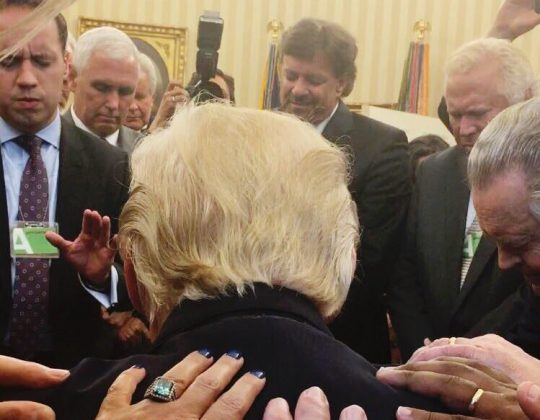 praying with Trump