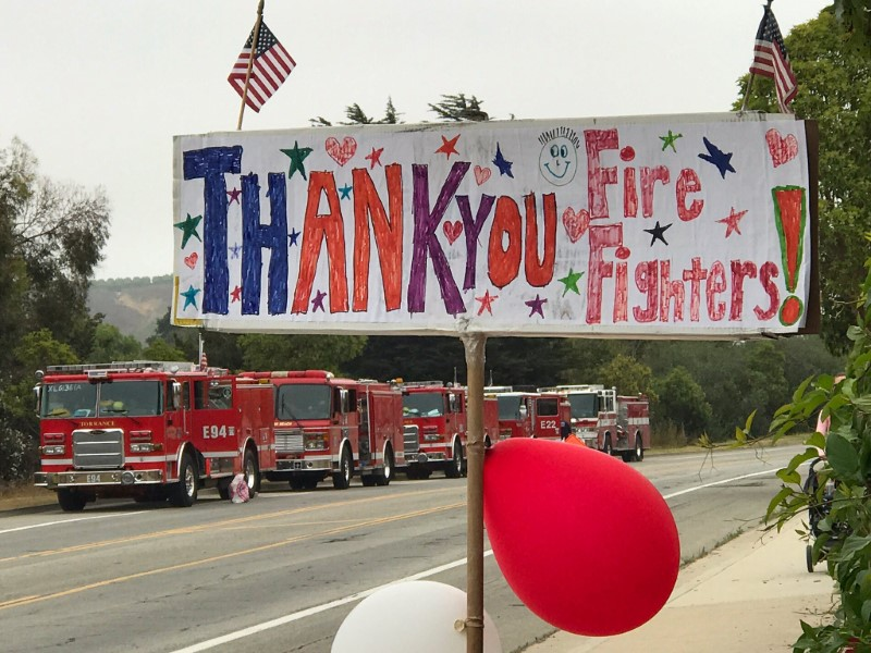 A hand drawn sign shows thanks to fire fighters heading out to tackle the Whittier fire near Santa Barbara, California, U.S. July 13, 2017. Mike Eliason/Santa Barbara County Fire/Handout via REUTERS