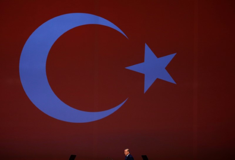 Turkish President Tayyip Erdogan walks to make a speech at the 22nd World Petroleum Congress in Istanbul, Turkey, July 10, 2017. REUTERS/Murad Sezer