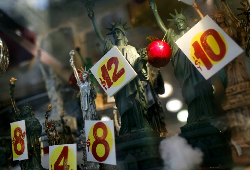 FILE PHOTO - Prices are seen on replica Statues of Liberty figures in a shop window in New York City, November 14, 2011. REUTERS/Mike Segar
