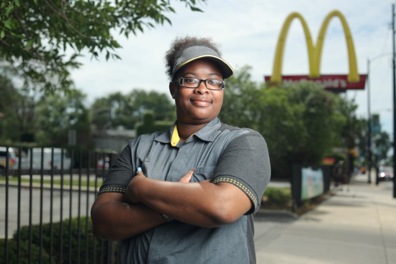 McDonald's employee Ashley Bruce poses in front of the restaurant where she works in Chicago, Illinois, U.S.