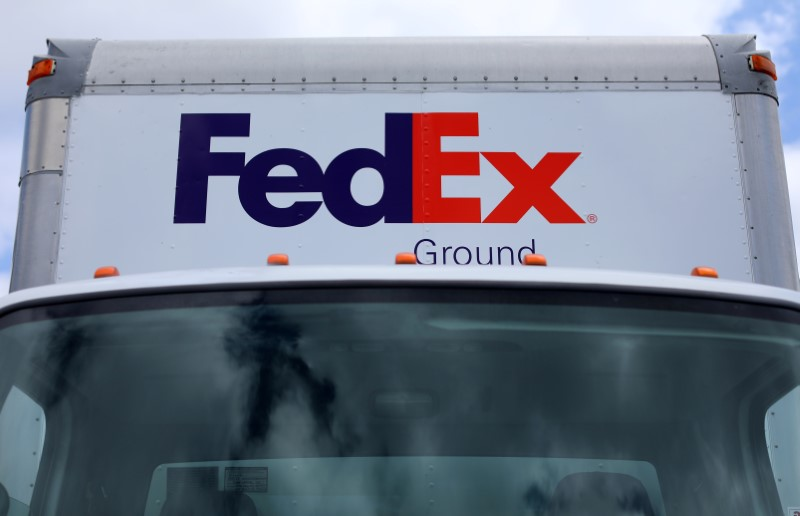 A Federal Express truck is shown on deliver in La Jola, California, U.S., May 17, 2017. REUTERS/Mike Blake
