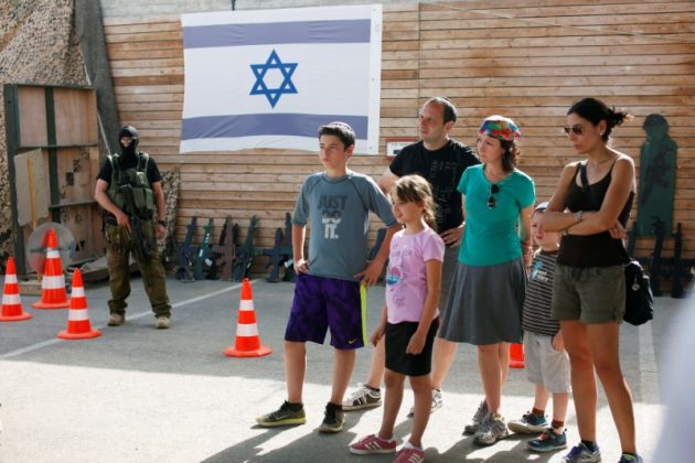 """A group of tourists take part in a two hour """"boot camp"""" experience, at """"Caliber 3 Israeli Counter Terror and Security Academy"""" in the Gush Etzion settlement bloc south of Jerusalem in the occupied West Bank July 13, 2017. REUTERS/Nir Elias"""
