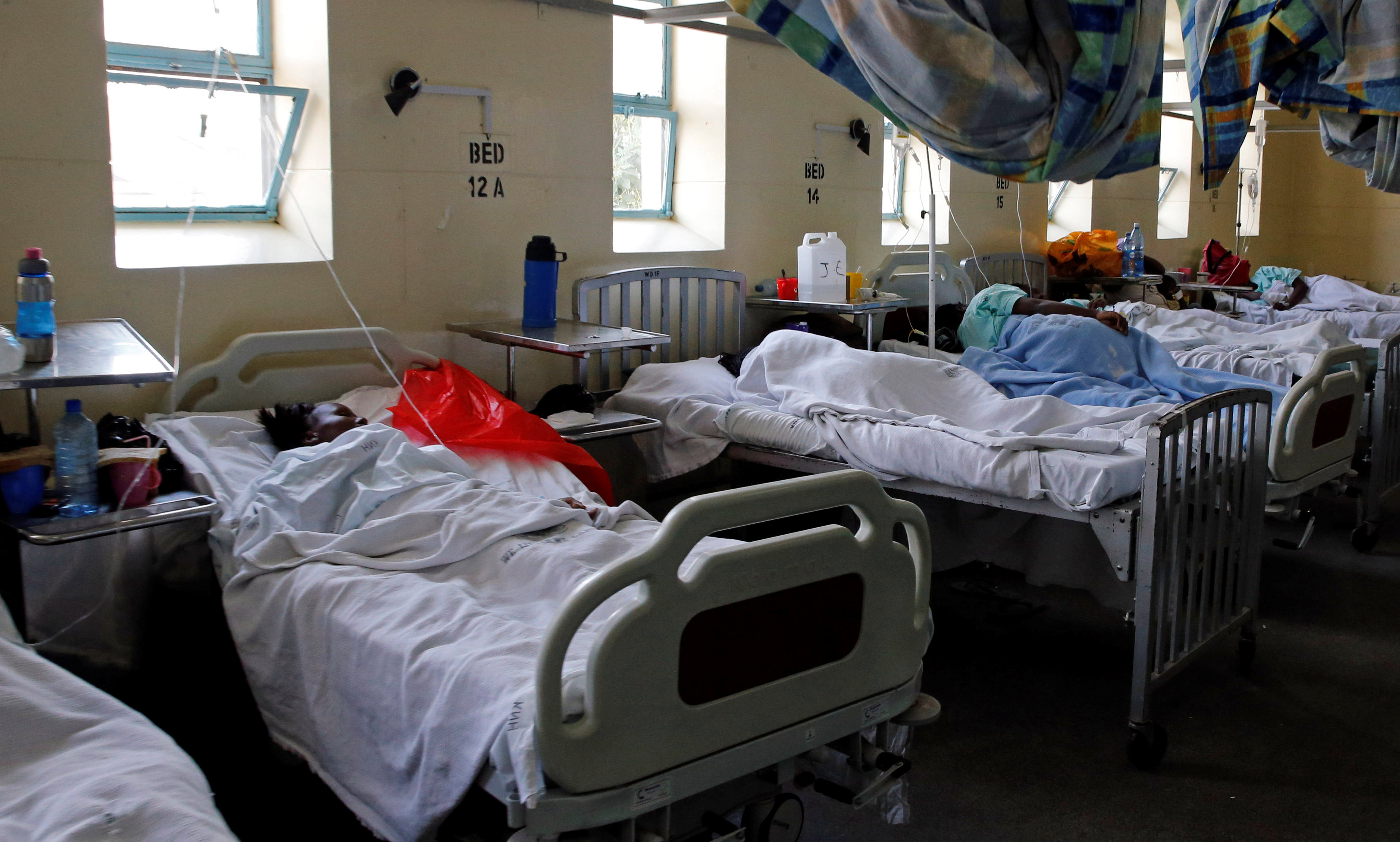 Cholera patients receive treatment and care inside a special ward at the Kenyatta National Hospital in Nairobi, Kenya July 19, 2017. REUTERS/Thomas Mukoya