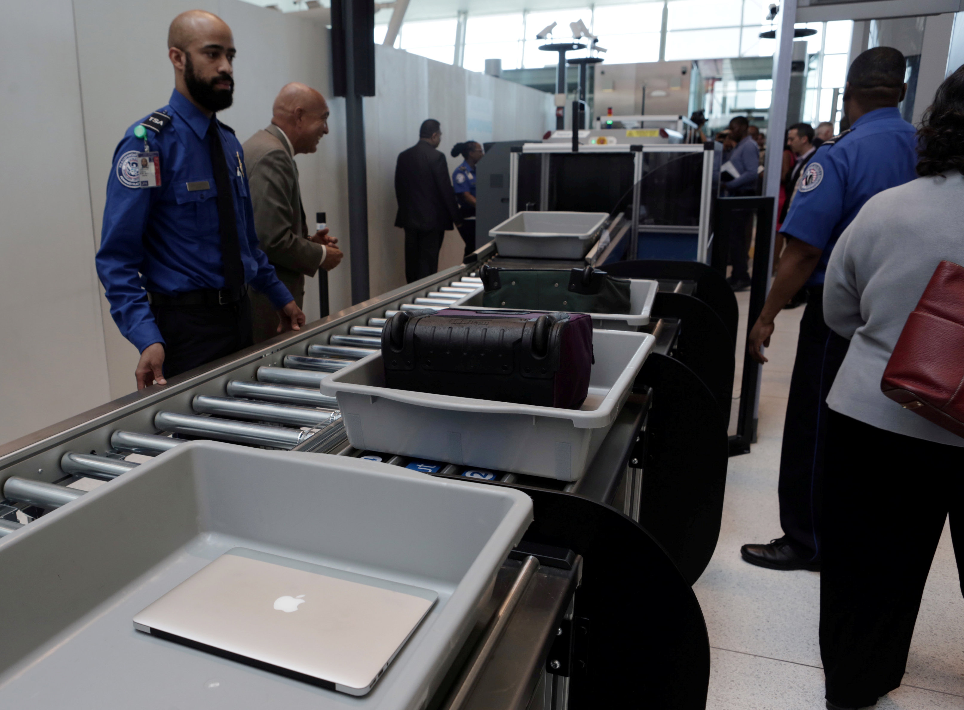 FILE PHOTO: Baggage and a laptop are scanned using the Transport Security Administration's new Automated Screening Lane technology at Terminal 4 of JFK airport in New York City, U.S., May 17, 2017. REUTERS/Joe Penney/File Photo