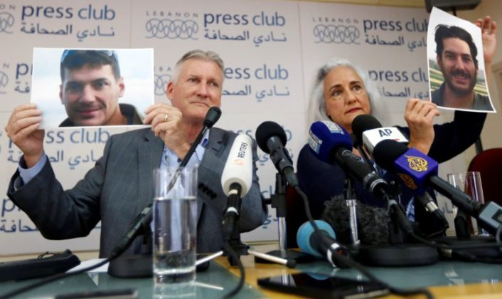 Debra Tice, the mother of American journalist Austin Tice, holds his picture with her husband Marc Tice during a news conference in Beirut, Lebanon July 20, 2017. REUTERS/Jamal Saidi