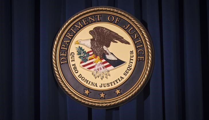 FILE PHOTO: The Department of Justice (DOJ) logo is pictured on a wall after a news conference in New York December 5, 2013. REUTERS/Carlo Allegri