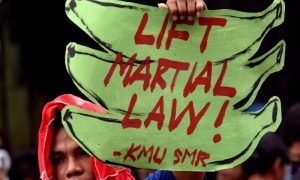 An anti martial law protestor hold a placard while protesting during the special session on the extension of martial law at the House of Representatives in Quezon City, metro Manila, Philippines July 22, 2017. REUTERS/Dondi Tawatao
