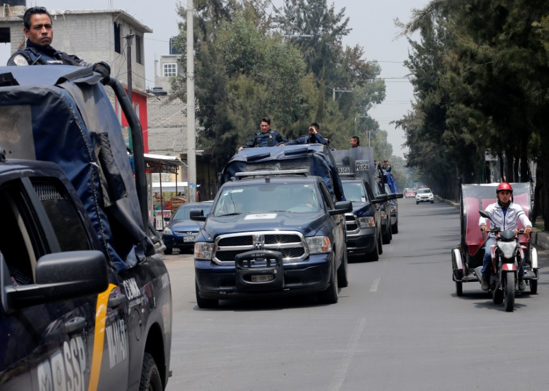 Police vehicles patrol the streets, after suspected gang members were killed on Thursday in a gun battle with Mexican marines in Mexico City, Mexico, July 21, 2017. REUTERS/Henry Romero