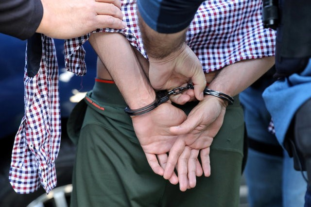 FILE PHOTO: U.S. Immigration and Customs Enforcement (ICE) Assistant Field Office Director Jorge Field (R), 53, and Field Office Director David Marin arrest a man in San Clemente, California, U.S., May 11, 2017. REUTERS/Lucy Nicholson/File Photo