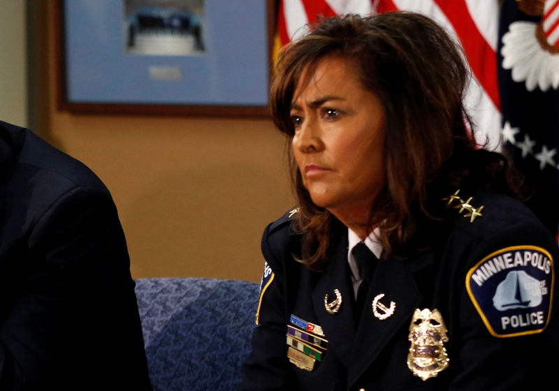 FILE PHOTO: Minneapolis Chief of Police Janee Harteau takes part in a round table discussion on ways to reduce gun violence during a visit to the Minneapolis Police Department Special Operations Center in Minneapolis, Minnesota, U.S. on February 4, 2013. REUTERS/Kevin Lamarque/File Photo