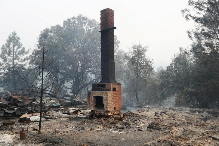 A chimney stands amidst remains of a home destroyed by the Detwiler fire in Mariposa, California U.S. July 19, 2017.