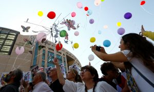 Journalists and press freedom activists release balloons during a demonstration in solidarity with the members of the opposition newspaper Cumhuriyet who were accused of supporting a terrorist group outside a courthouse, in Istanbul, Turkey, July 24, 2017.